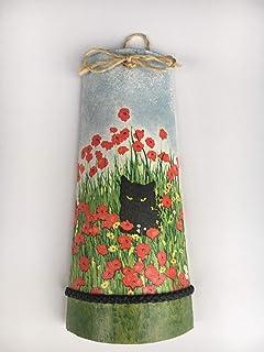 teja decorativa con gato entre flores