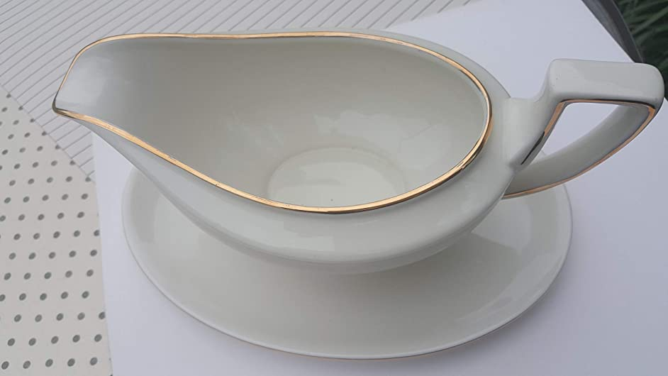 Large elegant gravy boat with attached rider