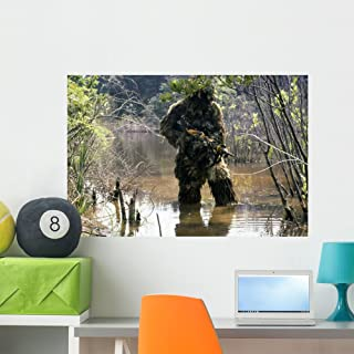 Sniper Dressed Ghillie Suit Wall Mural by Wallmonkeys Peel and Stick Graphic (36 in W x 24 in H) WM269784