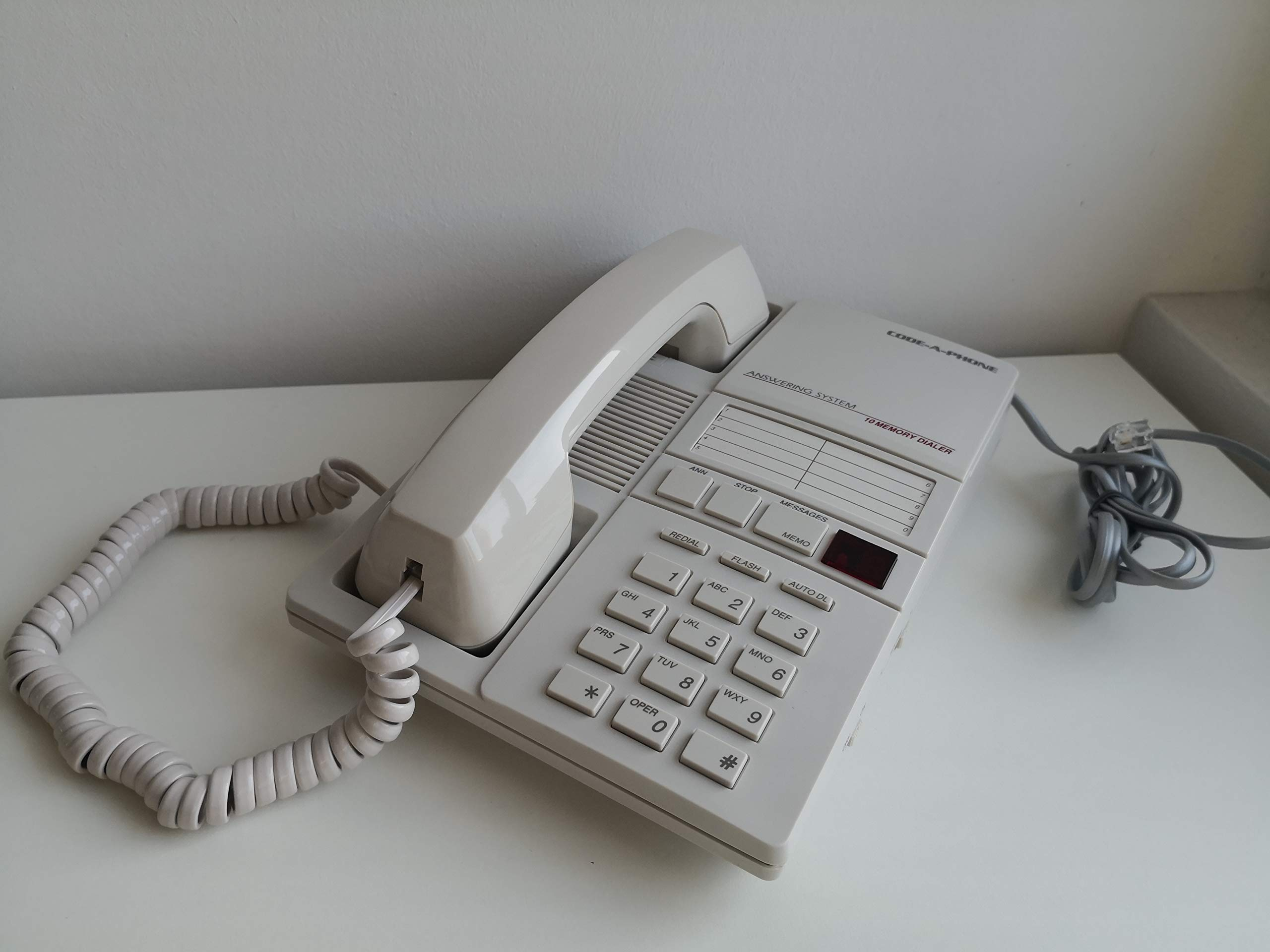 Code-A-Phone 1850 analogue telephone and integrated answer machine with microcassette.