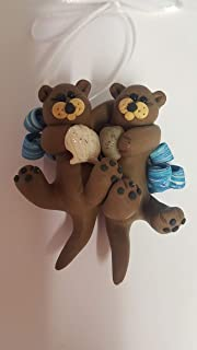 OTTER COUPLE CHRISTMAS ORNAMENT Sea Otter River Otter with Clam Floating on Back Hand Made Polymer Clay