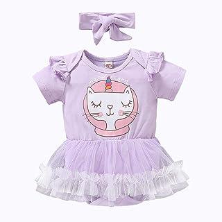 Klänning till baby med en katt som mönster, samt tillhörande pannband.