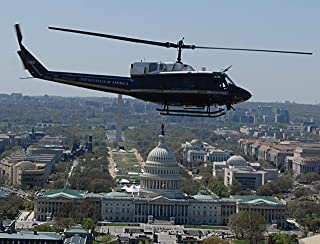 Home Comforts A 1st Helicopter Squadron UH-1N Huey Flies by The U.S. Capitol in Washington D.C. The 1 HS Performs Vivid Imagery Laminated Poster Print 24 x 36