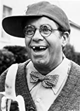 Jerry Lewis wearing glasses and a baseball cap Photo Print (8 x 10)