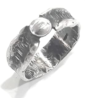 Mens rustic, forged, sterling black silver ring with molten border, and hammered texture of parallel lines.