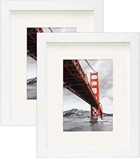 Frametory, Set of 2, 8x10 White Picture Frame - Made to Display Pictures 5x7 Photo with Ivory Color Mat - Wide Molding Real Glass - Preinstalled Wall Mounting Hardware (8x10 - Set of 2, White)