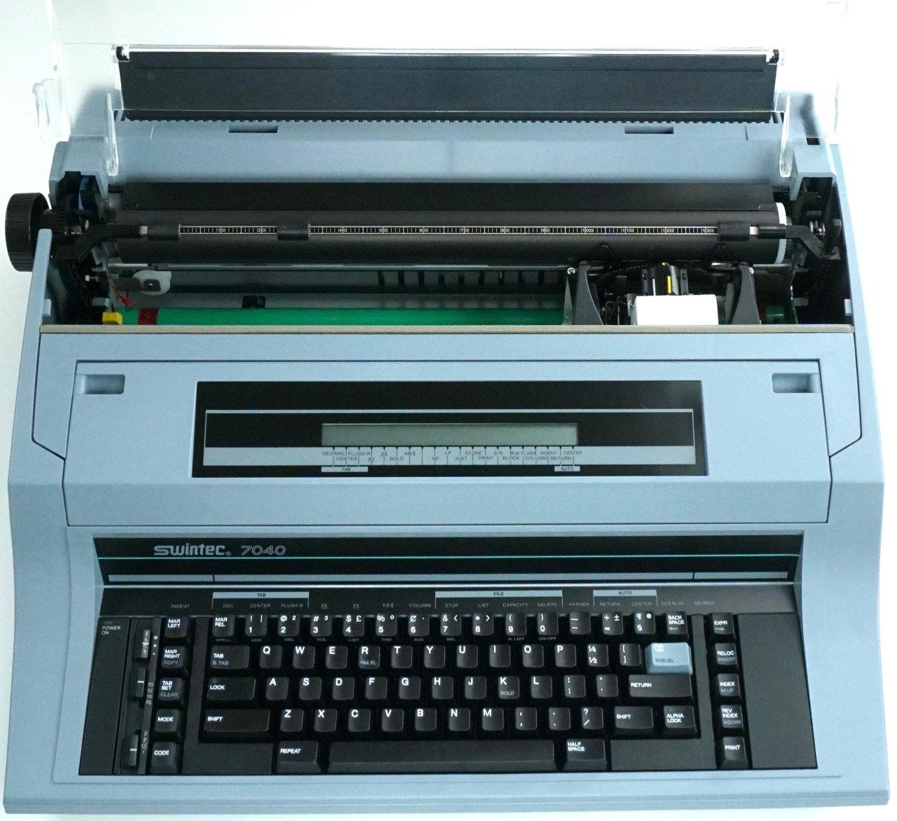 Marca nueva Swintec 7040 Heavy Duty electrónico máquina de escribir con 48 K carácter módulo de: Amazon.es: Oficina y papelería