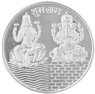 silver coin with laxmi