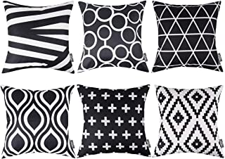 throw pillows on black couch