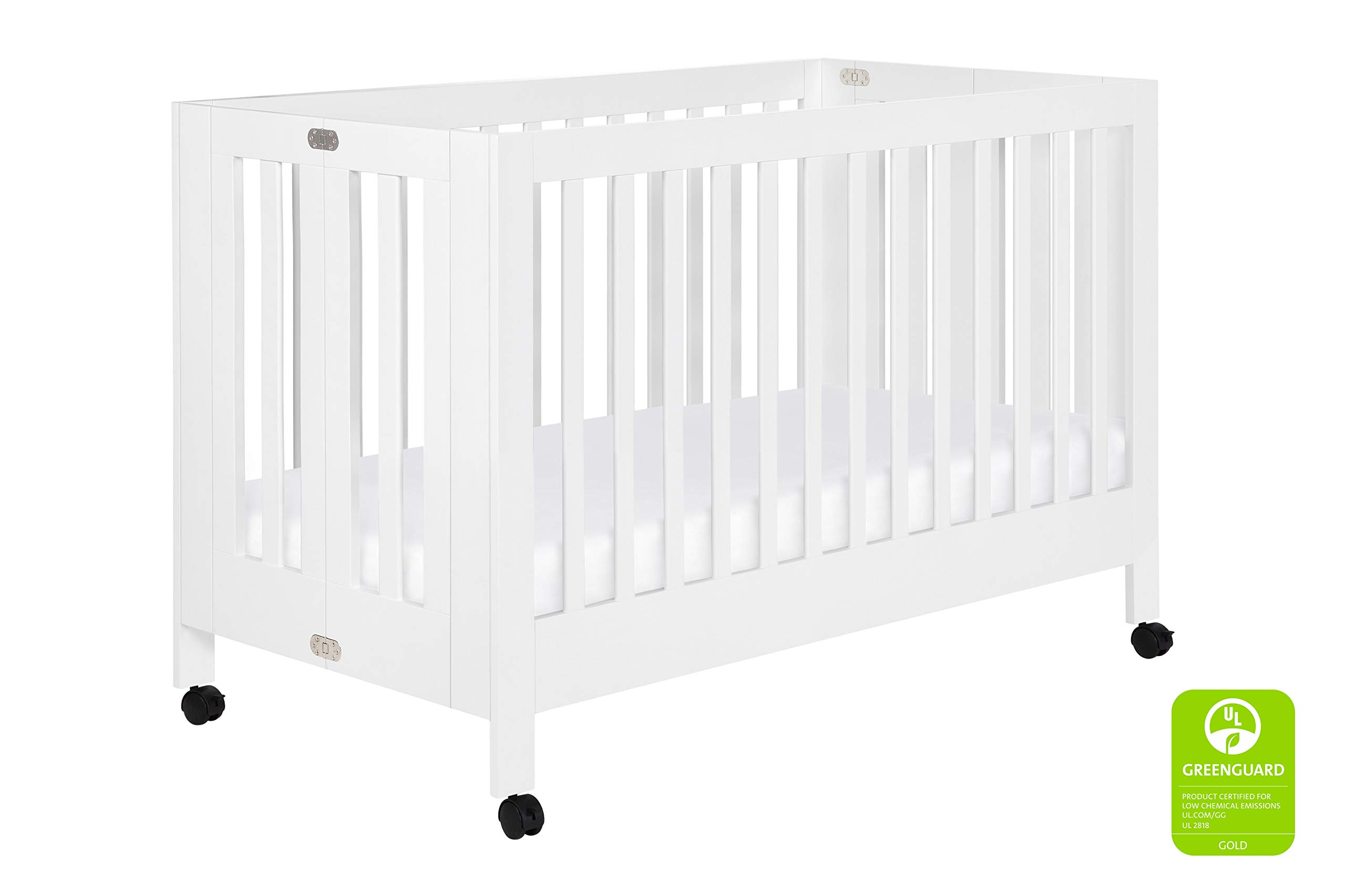 - Babyletto Maki Full-Size Portable Folding Crib With Toddler Bed