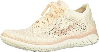 beige nike running shoes