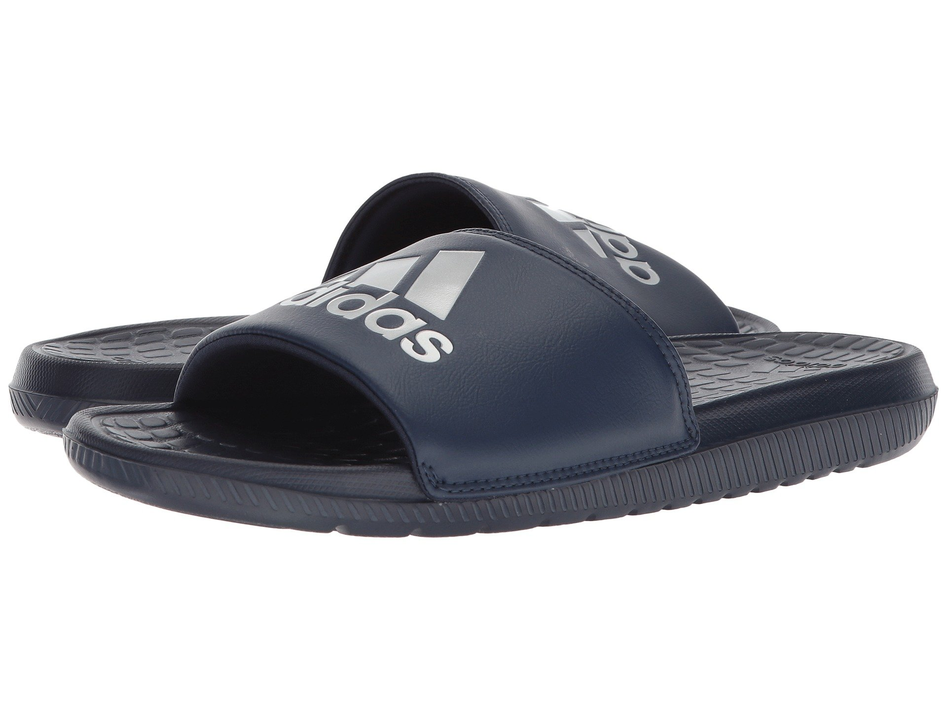 The casual comfort of the adidas® Voloomix is sure to become your go-to  weekend and post-workout sandal. Easy slip-on style. Foam-cushioned  man-made upper. bd696bf93