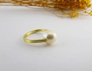 Anello in oro giallo e perla bianca