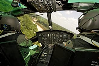 Posterazzi Two Veteran Instructor Pilots of The 23rd Training Squadron Practice Low Flying Operations in a UH-1H Huey South of Fort Rucker Alabama Poster Print, (17 x 11)