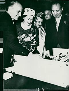 Vintage photo of English State Visit in Paris. Queen Elizabeth admires the gift of 12 dolls handed over to Princess Anne