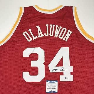 Autographed/Signed Hakeem Olajuwon Houston Red Basketball Jersey Beckett BAS COA