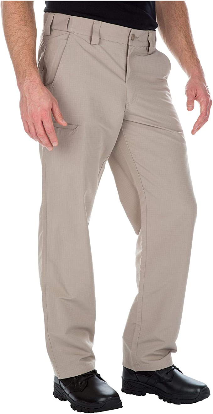 A man standing sideways wearing the 5.11 Lightweight Cargo Pants in khaki color.