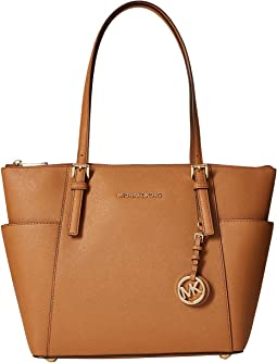 f09137c389089 Michael michael kors jet set travel logo small tote vanilla ...