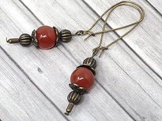 Orecchini Thurcolas in stile vintage in corniola rossa montati su fantasiosi cerchi in bronzo antico