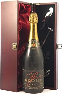 Granier Brut Vintage Champagne 1985 in a silk lined wooden box with four wine accessories, 1 x 750ml