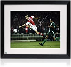 Dennis Bergkamp Signed Arsenal Soccer Photo: Shooting. Framed