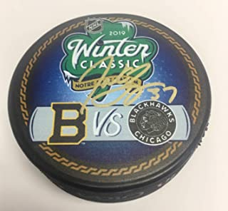 Patrice Bergeron Boston Bruins Signed Autographed 2019 Winter Classic Duel Puck Notre Dame