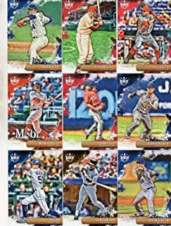 2019 Panini Diamond Kings Complete Hand Collated Baseball Set of 100 Base Cards - No Short Prints. Cards #1-100 only. Included in this set are Hall of Famers like Stan Musial, Babe Ruth, Roberto Clemente, Mel Ott, Tris Speaker, Mickey Mantle, Lou Gehrig, Yogi Berra, Joe DiMaggio, Jimmie Foxx, Ted Williams, Joe Jackson, Ty Cobb, Honus Wagner, Jackie Robinson, Nolan Ryan and many more. Also includes current stars like Ronald Acuna Jr., Paul Goldschmidt, Juan Soto, Justus Sheffield Aaron Judge