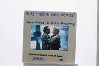 Slides photo of Actress Glenn Close having a romantic moment with actor Niels Arestrup in the movie