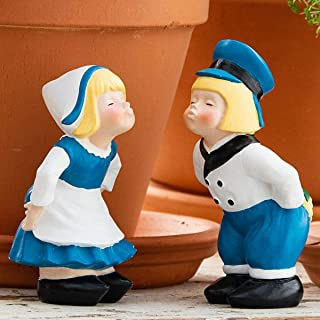 dutch boy and girl kissing garden statues