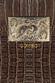 COWBOY: 6x9 lined journal with antique horse belt buckle on brown leather background