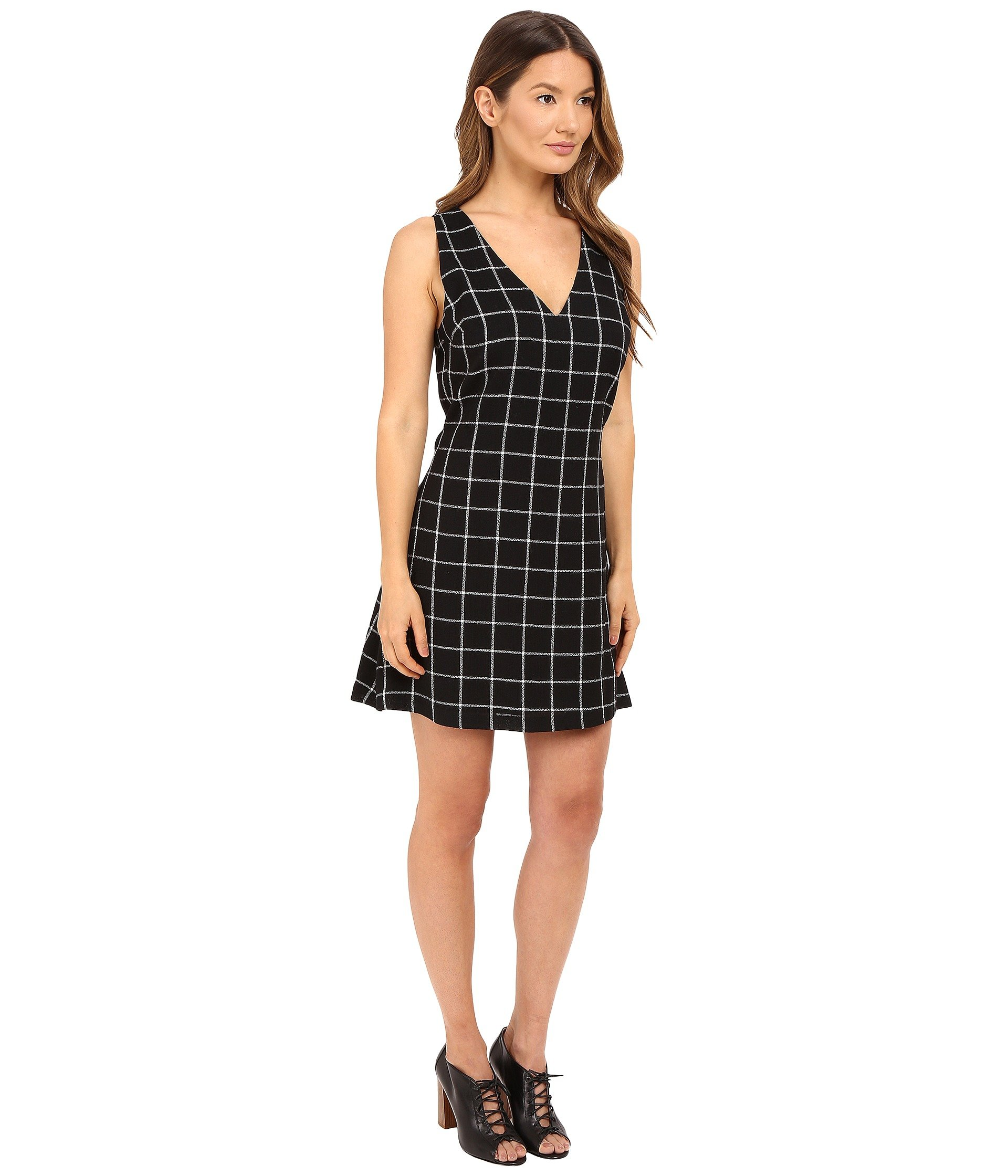 Sami & Jo short sleeve puff print inset sheath dress is a stunning stretch style with a boat neck front, and keyhole back. Semi-lined. Length: 38 inches. Self: 94% Polyester, 6% Spandex. Lining: % Polyester. Hand wash. Line dry.