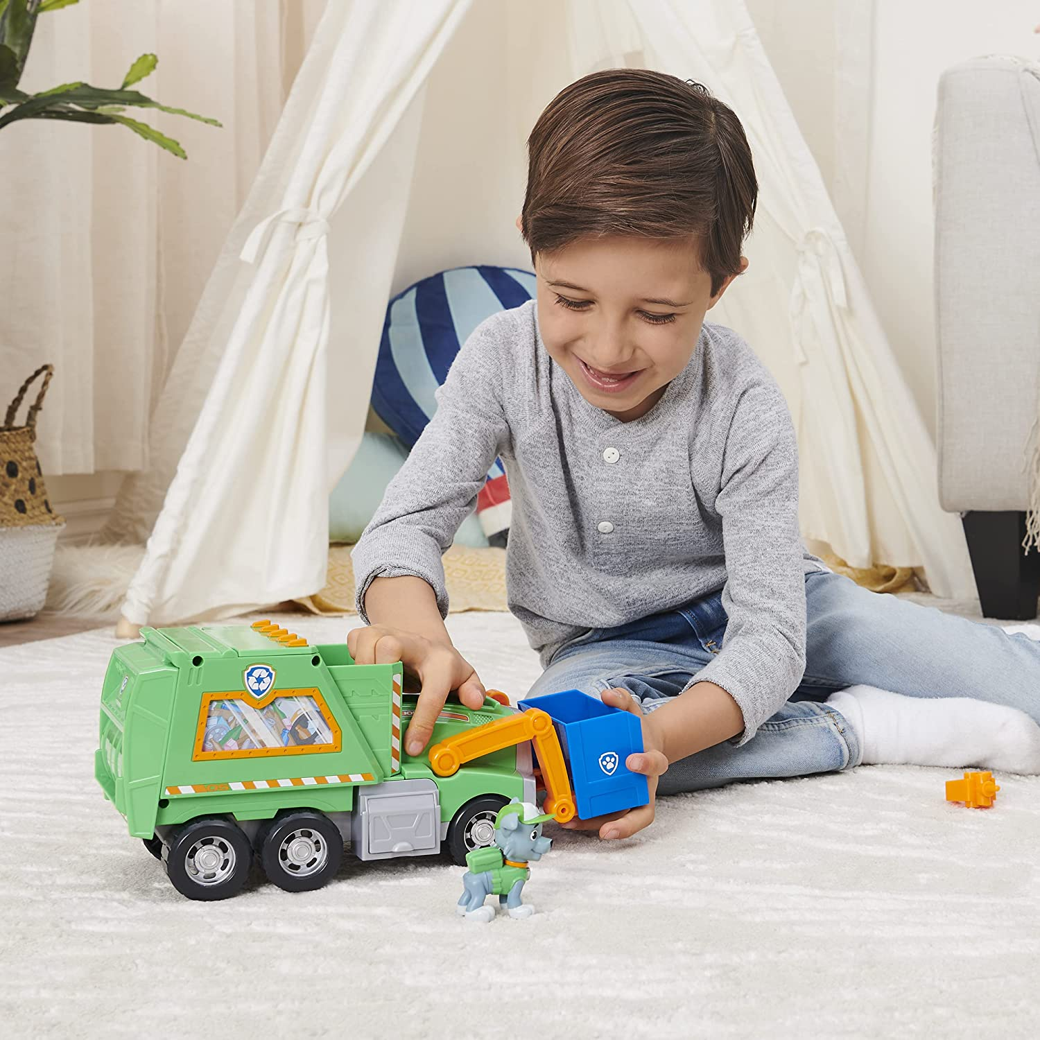 Rocky Reuse It Deluxe Truck - Boy with the toy, working out the functions