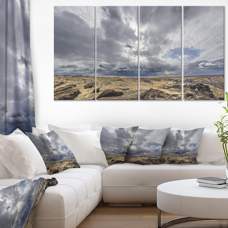 Amazon Com Designart Sky And Stones Under Dark Clouds Landscape Artwork Canvas 48x28 4 Piece 28 H X 48 W X 1 D 4p Posters Prints