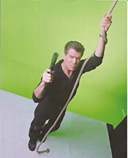 James Bond 007 Pierce Brosnan with gun holding rope in front of green screen - 8 x 10 Production Photo #1 - 004
