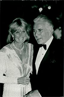 Vintage photo of John Forsythe along with Linda Evans during a Hollywood showdown