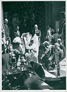 Vintage photo of Bridal couple crown prince Frederik of Denmark and princess Ingrid of Sweden on the stork church staircase under the rain of rice porridge after the wedding