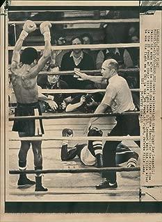 Vintage photo of Sugar Ray Leonard and referee mills lane.