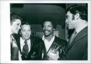 Vintage photo of Jo Ann Pflug, Wendell Niles Jr, Rams footballer Kermit Alexander and former pro-football star turned actor, Mike Henry at Niles39; party for film and sports friends at the bistro.