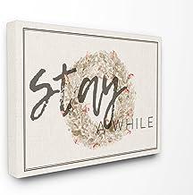لوحة فنية جدارية من القماش ممتدة الحجم مكتوب عليها Stay A While Strawflower Wreath من Stupell Industries مقاس 24 × 1.5 × 3...