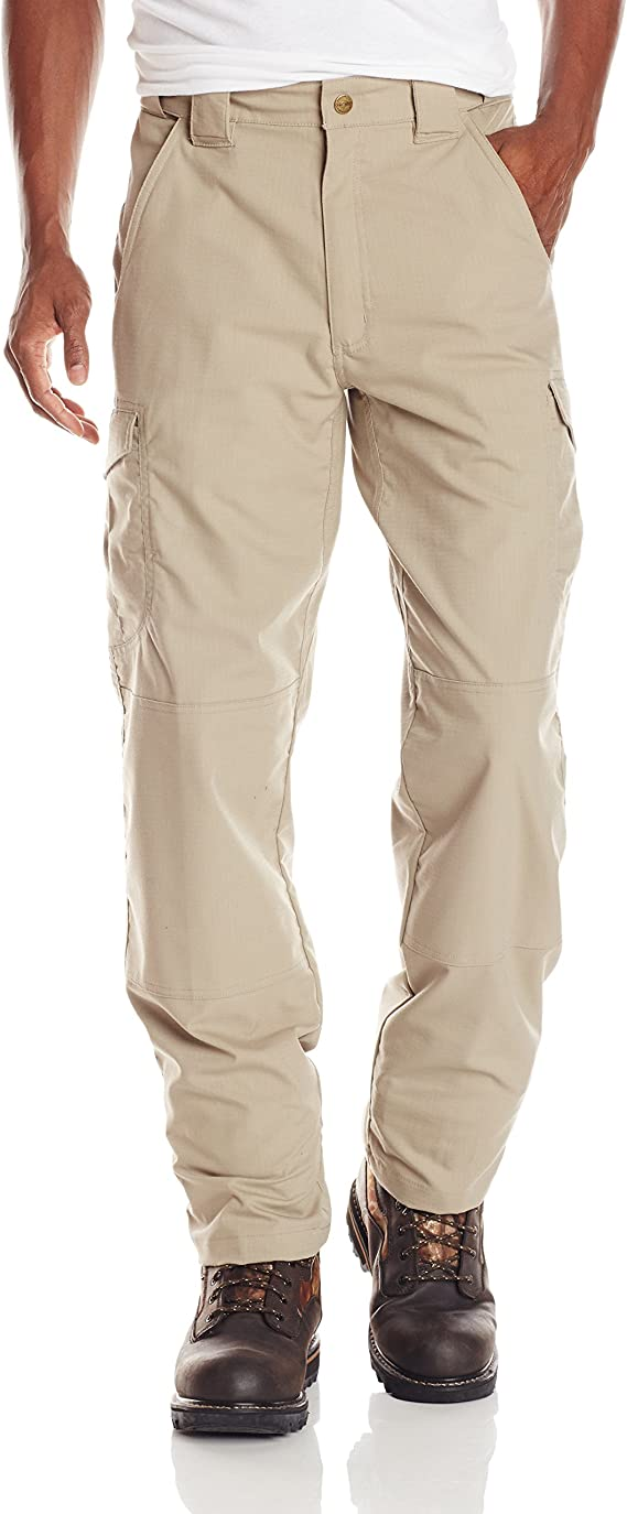 Image of a man wearing a tactical pants in khaki shade, one hand in the pants side pocket.