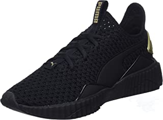 PUMA Women's Defy Varsity WN's Blk-Gold Shoes, Black-Metallic Gold