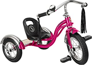 pink tricycle with tassels