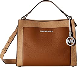 4f315abee MICHAEL Michael Kors. Delaney Medium Top-Handle Canteen Messenger. $228.00.  Acorn/Butternut