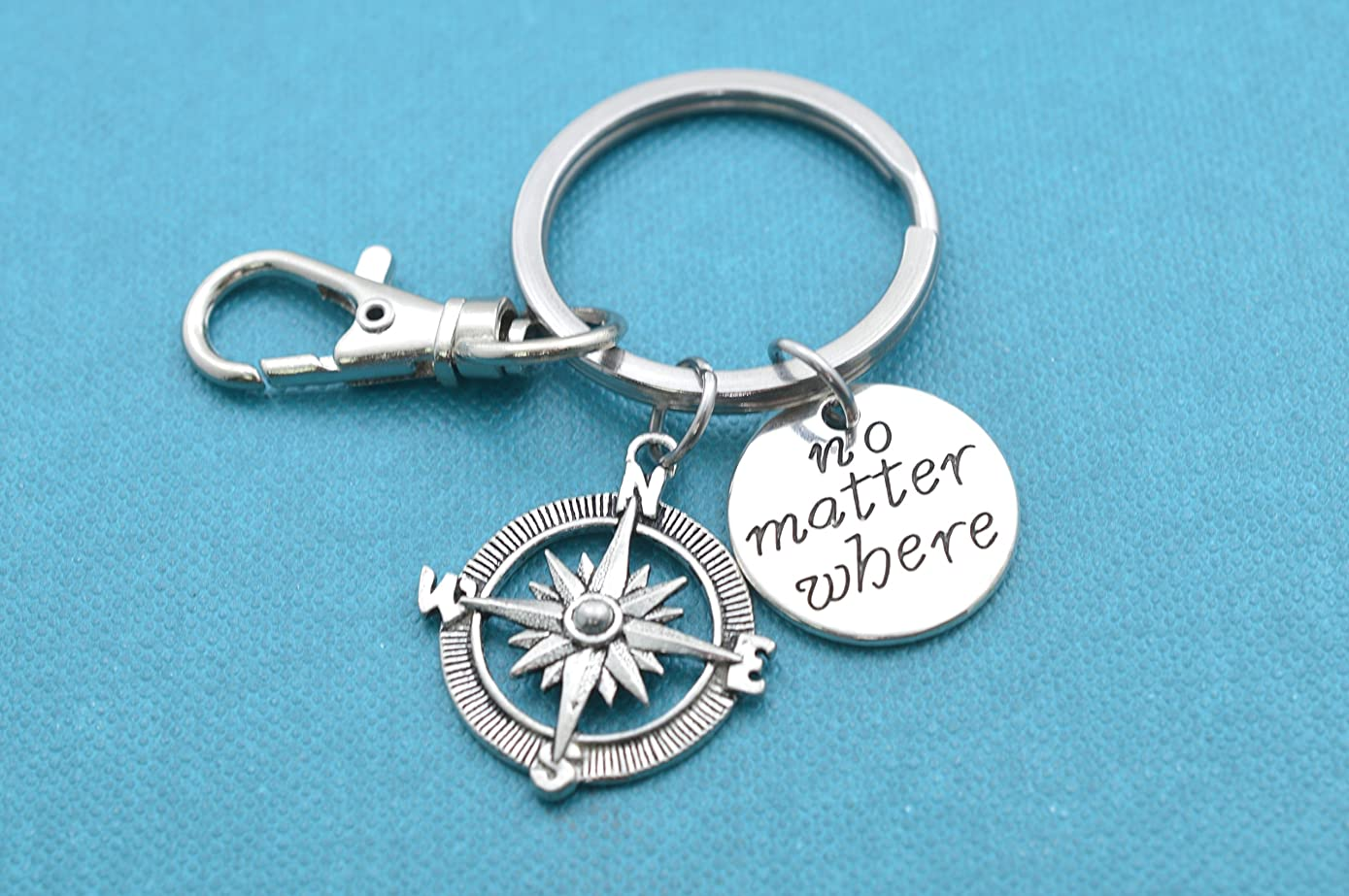 No matter where keychain with silver toned metal word tag on stainless steel key ring and snap hook. Gift for him. Gift for her.