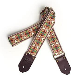 The Poncho Guitar Strap- woven southwest native design embroidered in brown green red yellow and white on tan back ground with leather ends