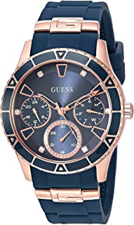 GUESS Rose Gold-Tone + Iconic Blue Stain Resistant Silicone Watch with Day, Date + 24 Hour Military/Int'l Time. Color: Blue (Model: U1157L3)