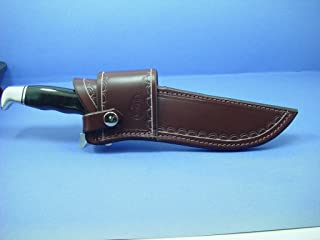 Custom cross draw knife sheath for a buck 120 knife. This sheath is made out of 10 ounce water buffalo hide leather. The water buffalo leather is very soft durable and pliable. The sheath can be worn on the right or left hand side. Comes with a snap that secures the knife in place on both sides. The sheath is dyed dark brown with border tooling. This is for sheath only the knife is not included.