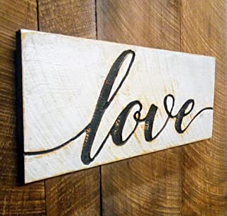"Sometimes it can be hard to find cute farmhouse Valentine's Day decor, but you're in luck. This cute wooden ""love"" sign is so cute and the perfect addition to any home."