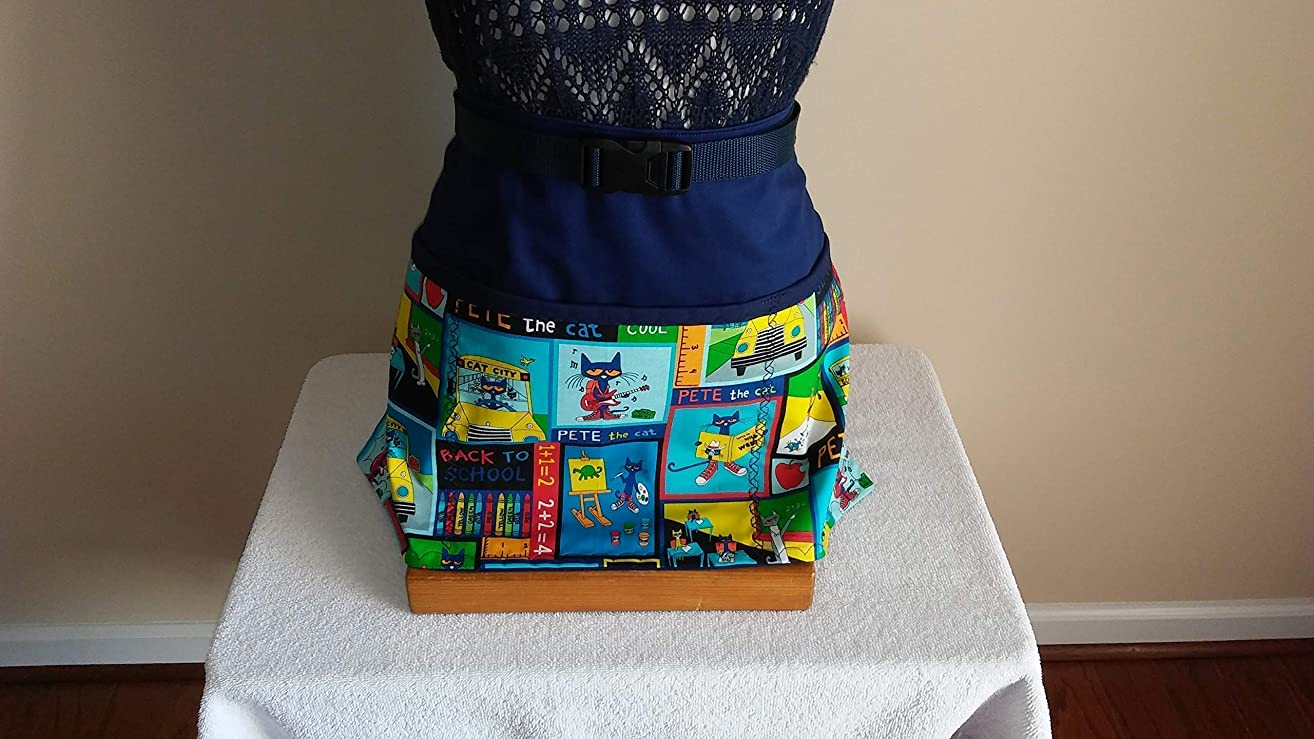 ADJUSTABLE NO TIE APRON -LIMITED EDITION/PETE THE CAT/Navy background/Navy binding on top of pockets/One size fits most/The Perfect Teacher's Gift