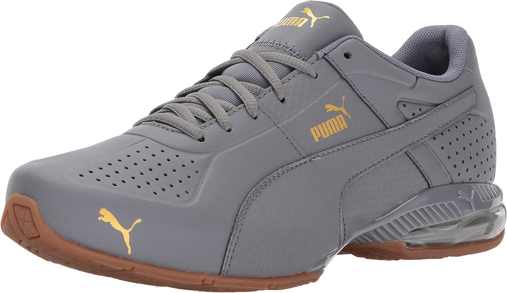 Amazon.com   PUMA Men's Cell Surin 2 Sneaker, Quiet Shade-Gold ...